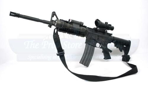 Hey, an actually relevant picture! That's the rifle we're using: the M-4 carbine with collapsible stock, with the M-68 Close Combat Optic (CCO). It basically has a frickin' laser. Sweet.